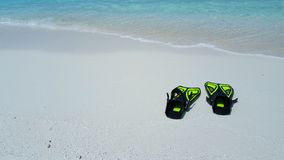 P01891 Maldives white sandy beach fins snorkel mask scuba flippers on sunny tropical paradise island with aqua blue sky Stock Images