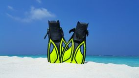 P01898 Maldives white sandy beach fins snorkel mask scuba flippers on sunny tropical paradise island with aqua blue sky Royalty Free Stock Photography