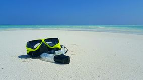 P01915 Maldives white sandy beach fins snorkel mask scuba flippers on sunny tropical paradise island with aqua blue sky. Maldives white sandy beach fins snorkel stock images