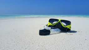 P01903 Maldives white sandy beach fins snorkel mask scuba flippers on sunny tropical paradise island with aqua blue sky Royalty Free Stock Images