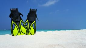 P02993 Maldives white sandy beach fins snorkel mask scuba flippers on sunny tropical paradise island with aqua blue sky Royalty Free Stock Photos