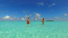 P02945 Maldives white sandy beach 2 people a young couple man woman romantic love on sunny tropical paradise island with Stock Image