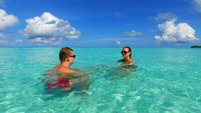 P02942 Maldives white sandy beach 2 people a young couple man woman romantic love on sunny tropical paradise island with Stock Photography