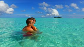 P02946 Maldives white sandy beach 2 people a young couple man woman romantic love on sunny tropical paradise island with Royalty Free Stock Photography