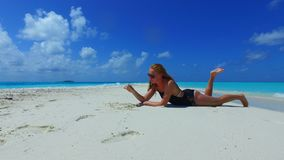P02710 Maldives white sandy beach 1 person young beautiful woman relaxing on sunny tropical paradise island with aqua Royalty Free Stock Image