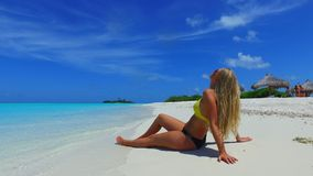 P02736 Maldives white sandy beach 1 person young beautiful woman relaxing on sunny tropical paradise island with aqua Royalty Free Stock Photo