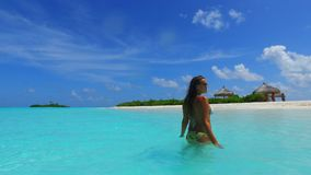 P02737 Maldives white sandy beach 1 person young beautiful woman relaxing on sunny tropical paradise island with aqua Stock Image