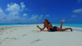 P02709 Maldives white sandy beach 1 person young beautiful woman relaxing on sunny tropical paradise island with aqua Stock Photos