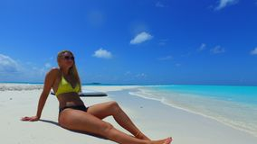 P02729 Maldives white sandy beach 1 person young beautiful woman relaxing on sunny tropical paradise island with aqua Royalty Free Stock Image