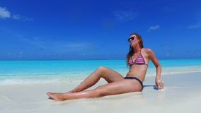 P02733 Maldives white sandy beach 1 person young beautiful woman relaxing on sunny tropical paradise island with aqua Royalty Free Stock Photo