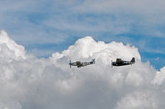 P-51 Mustang Sierra Sue II and FM-@ Wildcat Avenger Against Clou Stock Photos