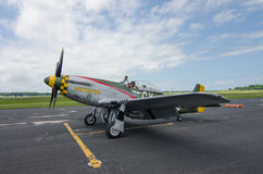 P-51 Mustang. A WWII era P-51 Mustang fighter sits on a tarmac during an historical airshow Royalty Free Stock Photos