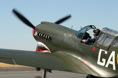 WWII Kittyhawk waits for flight Royalty Free Stock Photo