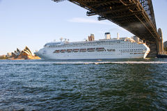 Sydney Harbour bridge Opera house cruise ship. P&O Pacific Jewel passing under the harbour bridge and in front of the opera house Sydney harbour. Space for text royalty free stock image