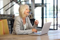Happy older business woman working on laptop. P{portrait of happy older business woman working on laptop Royalty Free Stock Images