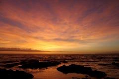 Pôr do sol no passeio à beira mar Imagens de Stock Royalty Free