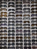 P Sunglasses are many by series in the store glasses Royalty Free Stock Photo