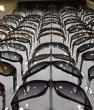 P Sunglasses are many by series in the store glasses Stock Images