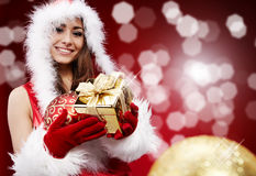 P woman with Christmas present Royalty Free Stock Photography