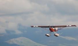 Pływakowy samolot w niebie Obrazy Royalty Free