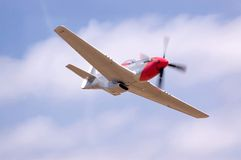 P51 Flyby. A restored P51 fighter airplane doing a fast flyby at an airshow Stock Photo