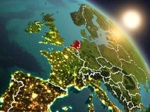 Países Baixos do espaço durante o nascer do sol ilustração royalty free