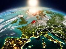 Países Baixos no nascer do sol da órbita ilustração do vetor