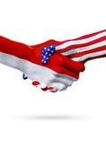 Países das bandeiras Mônaco e do Estados Unidos, aperto de mão overprinted Foto de Stock