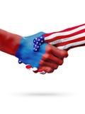 Países das bandeiras Mongólia e do Estados Unidos, aperto de mão overprinted Fotografia de Stock