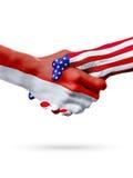 Países de las banderas Indonesia y de Estados Unidos, apretón de manos sobreimpreso Imagen de archivo