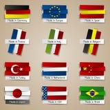 Países diferentes feitos nos crachás Fotos de Stock