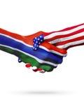 Países do Estados Unidos de Gambiaand das bandeiras, aperto de mão overprinted Imagem de Stock Royalty Free