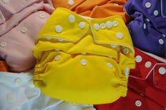 Pañales del paño en diversos colores Imágenes de archivo libres de regalías