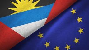 Paño de la materia textil de las banderas de Antigua y de Barbuda y de la unión europea dos, textura de la tela ilustración del vector