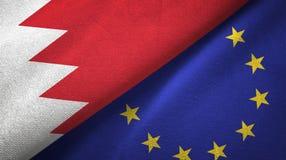 Paño de la materia textil de las banderas de Bahrein y de la unión europea dos, textura de la tela stock de ilustración