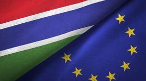 Paño de la materia textil de las banderas de Gambia y de la unión europea dos, textura de la tela stock de ilustración