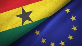 Paño de la materia textil de las banderas de Ghana y de la unión europea dos, textura de la tela ilustración del vector