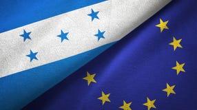 Paño de la materia textil de las banderas de Honduras y de la unión europea dos, textura de la tela ilustración del vector
