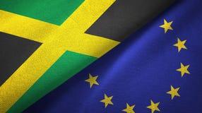Paño de la materia textil de las banderas de Jamaica y de la unión europea dos, textura de la tela stock de ilustración