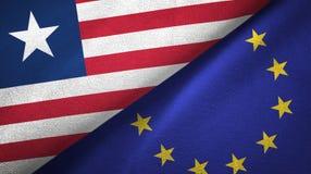 Paño de la materia textil de las banderas de Liberia y de la unión europea dos, textura de la tela stock de ilustración