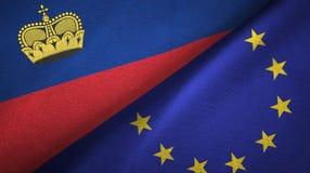 Paño de la materia textil de las banderas de Liechtenstein y de la unión europea dos, textura de la tela ilustración del vector