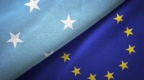 Paño de la materia textil de las banderas de Micronesia y de la unión europea dos, textura de la tela stock de ilustración