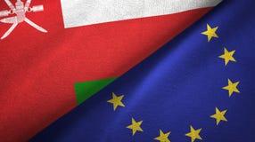 Paño de la materia textil de las banderas de Omán y de la unión europea dos, textura de la tela libre illustration