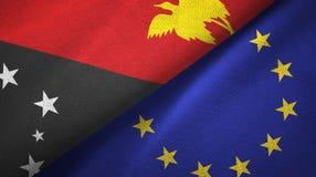 Paño de la materia textil de las banderas de Papúa Nueva Guinea y de la unión europea dos, textura de la tela libre illustration