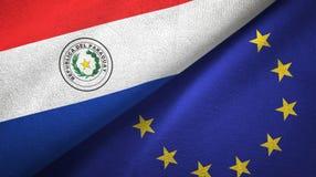 Paño de la materia textil de las banderas de Paraguay y de la unión europea dos, textura de la tela stock de ilustración