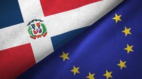 Paño de la materia textil de las banderas de la República Dominicana y de la unión europea dos, textura de la tela ilustración del vector