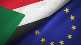Paño de la materia textil de las banderas de Sudán y de la unión europea dos, textura de la tela ilustración del vector