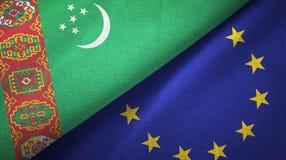 Paño de la materia textil de las banderas de Turkmenistán y de la unión europea dos, textura de la tela ilustración del vector