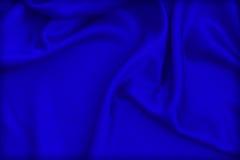 Paño de lujo del fondo abstracto o dobleces líquidos del onda u ondulados de Fotos de archivo