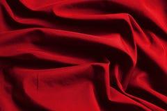 Paño de lujo del fondo abstracto o dobleces líquidos del onda u ondulados de la textura roja del paño Imagen de archivo libre de regalías